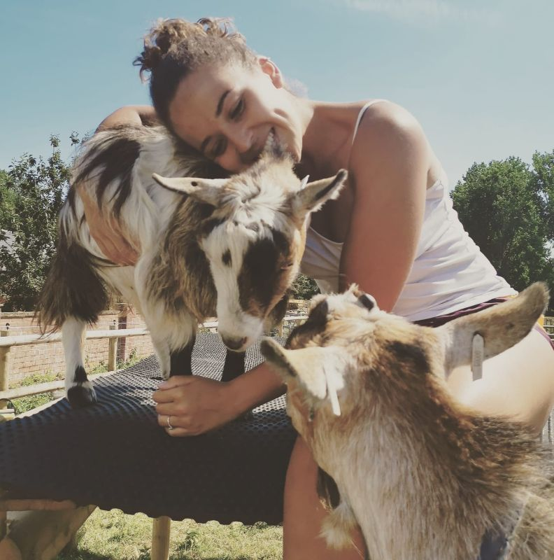 kayleigh hugging a pygmy goat