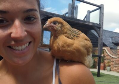 kayleigh with hen on her shoulder